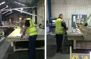 workers cutting and adjusting the sheets of metal for cnc machine