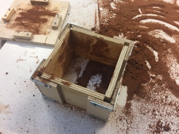 Sanded desktop so that the clay does not stick to the surface and it is easier to mould. The mould is also sanded to ensure the brick doesn't get stuck inside the mould.